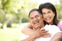 middle_age_couple_smile_hug.jpg
