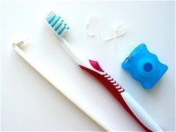 toothbrush toothpaste and floss