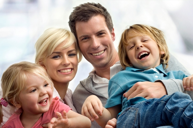 Family with beautiful smiles by our dentists in Baltimore, MD