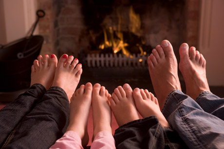 four_family_feet_by_fireplace.jpg