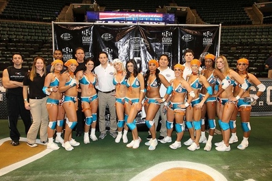 Dr. Cooper, seen here with Dr. Pardave, is the official team doctor for the Miami Caliente, lingerie football league.