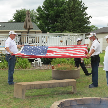 Kevin and Jeff preparing one of the flags for the ceremony.
