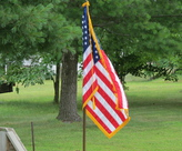 """The United States Flag Code states: """"The flag, when it is in such condition that it is no longer a fitting emblem of display, should be destroyed in a dignified way, preferably by burning."""""""